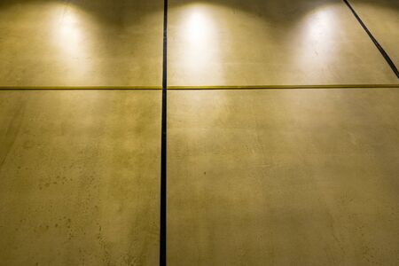 Polished concrete interior wall panels in diminishing perspective and dim light with copy spalce