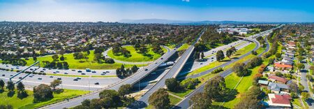 Wide aerial panorama of highway interchange on sunny day Stockfoto