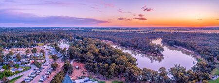 Aerial panorama of Murray River and holiday park at sunset. Moama, New South Wales, Australia