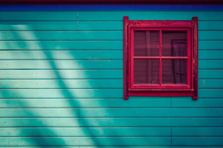 Square window on wooden cabin side with copy space Stockfoto