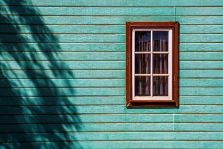 Window on weatherboard cabin wall with copy space