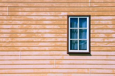 Window on wooden weatherboard wall with copy space Stock Photo