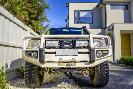 4WD truck with bull bar parked in a driveway front view