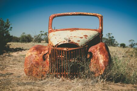 Neglected antique automobile somewhere in Australian desert