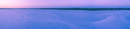 Wide aerial panoramic landscape of pink salt lake at dusk in Australia