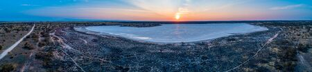 Sunset over salt lake Crosbie in Australia - aerial panorama