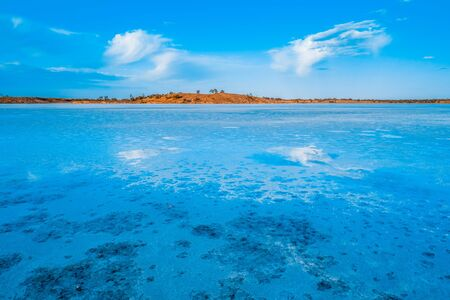 Cloud reflections in the salt of Lake Crosbie in Australia Stok Fotoğraf