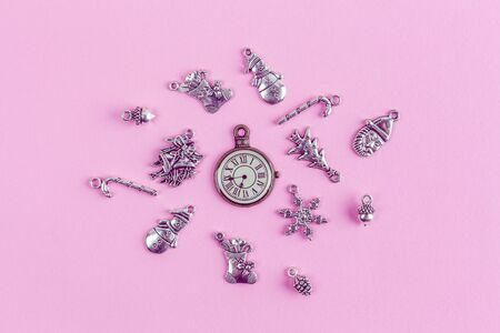 Christmas decorations and vintage clock on pink background flat lay - holidays theme Stok Fotoğraf