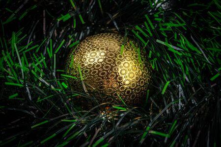 Extreme closeup of shiny gold Christmas bauble Фото со стока