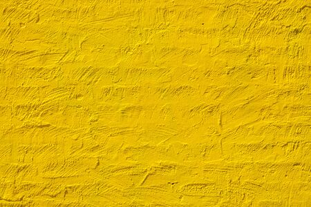 Painted yellow brick wall with copy space