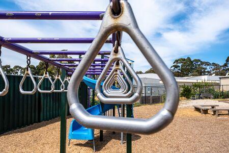 Triangular monkey bars closeup on kids playground Фото со стока