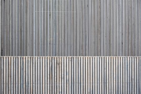 Modern building exterior made of wooden planks background with text space Фото со стока