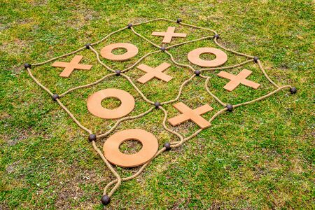 Large tic tac toe yard game placed on the grass