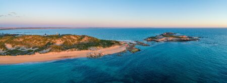Cape Martin Lighthouse and Penguin Island at dusk - aerial panorama