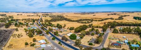 Wide aerial panoramic landscape of rural road passing through small township of Streatham in Victoria, Australia