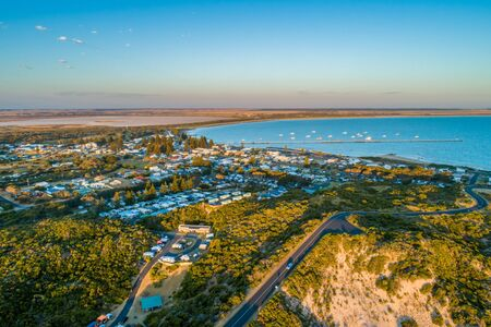 Aerial view of Beachport township and jetty at sunset