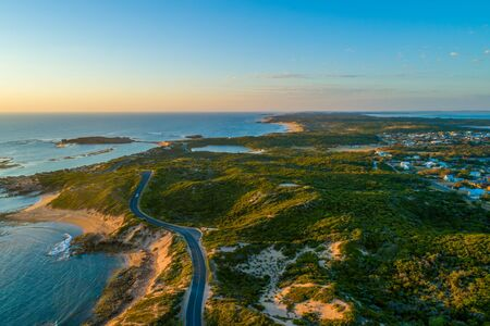 Bowman scenic drive passing along beautiful ocean coastline of Beachport, South Australia at sunset - aerial view