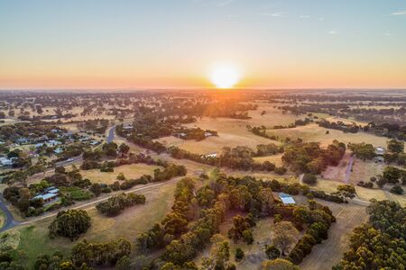 Sunset over pastures in Australian outback - aerial view