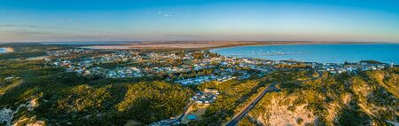 Beachport town located on ocean shore in South Australia - wide aerial panorama at sunset