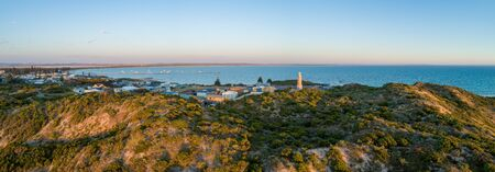 Cape Martin Lighthouse at sunset. Beachport, South Australia - wide aerial panorama 版權商用圖片