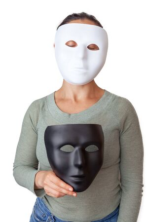 Caucasian woman wearing white face mask while holding a black face mask