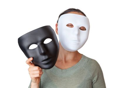 Woman wearing white face mask while holding a black face mask - isolated on white background