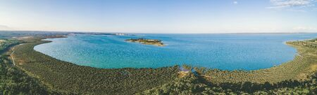 Wide aerial panorama of Western Port Bay and coastal wetlands from Crib Point, Victoria, Australia