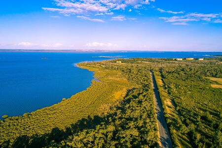 Aerial view of coastal wetlands and Woolleys road on Mornington Peninsula, Australia