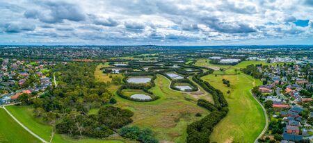 Scenic Tirhatuan Wetlands near suburban areas in Melbourne, Australia - wide aerial panorama Stock Photo
