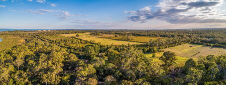 Scenic aerial panorama of agricultural land and native trees on Mornington Peninsula, Victoria, Australia