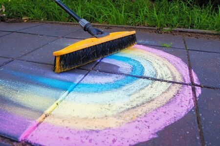Erasing chalk colorful rainbow with broom closeup Banco de Imagens
