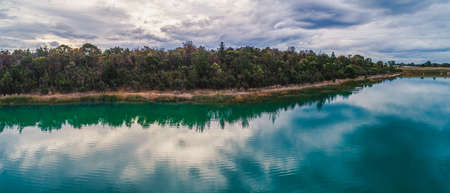 Panoramic view of native Australian vegetation reflecting in the lake water
