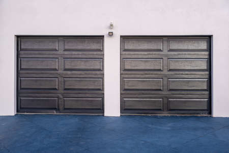 Modern townhouse garage doors - front view