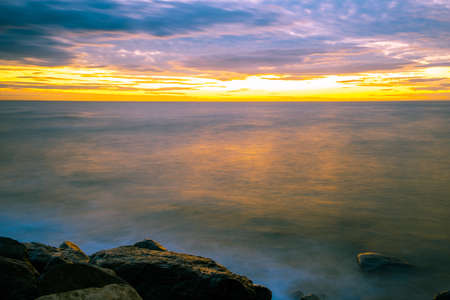Long exposure seascape with silky smooth water at sunset