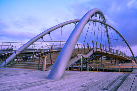 Frankston footbridge over Kananook creek at dusk. Melbourne, Australia