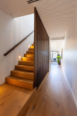 Wooden stairs leading to second floor of modern townhouse