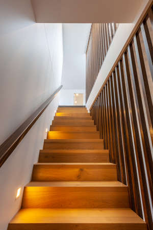 Wooden staircase looking up. Modern home interior. Banco de Imagens