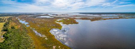 Large coastal salt water lake in Gippsland, Australia - aerial panorama 写真素材