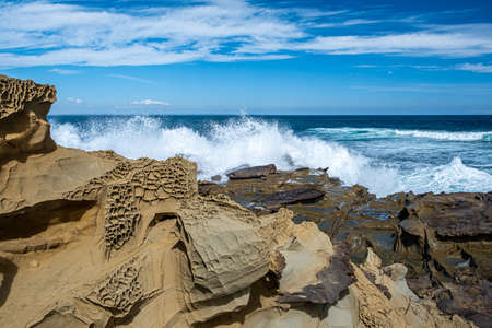 Powerful ocean waves crushing on sharp rocks - landscape