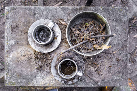Set of old coffee cups with leftovers and dirt - top down view