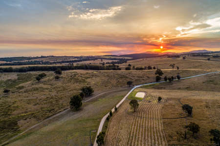 Scenic sunset over Australian countryside - aerial view 写真素材