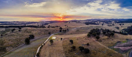 Aerial panorama of sunset over fields and hills in Australia
