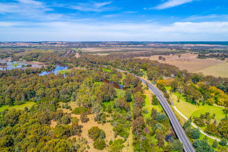 Aerial view of Thomson River and rural highway near Sale, Victoria, Australia 写真素材