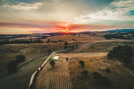Beautiful sunset over agricultural land in Victoria, Australia - aerial view