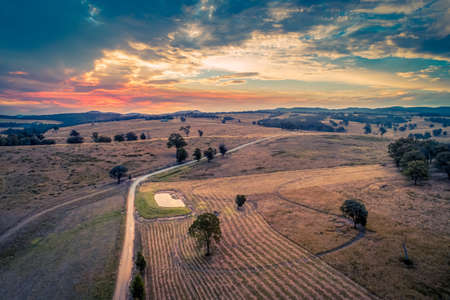 Beautiful sunset over fields - aerial view