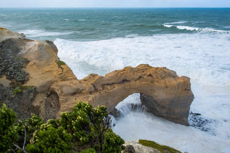 The Arch - limestone rock formation on the famous Great Ocean Road, Victoria, Australia Stock Photo
