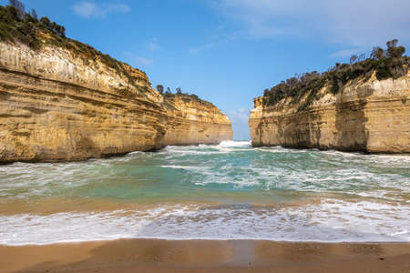 Loch Ard Gorge beach and strong ocean waves on Great Ocean Road in Australia