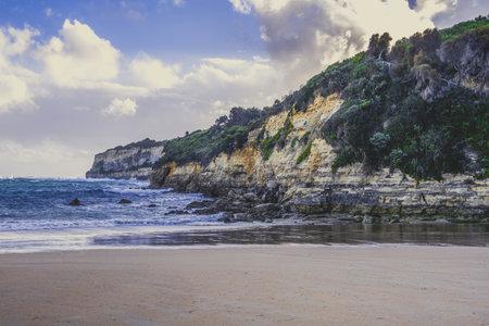 Limestone cliffs over ocean waves in Australia