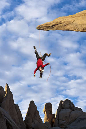 Climber in trouble at the end of his rope. photo
