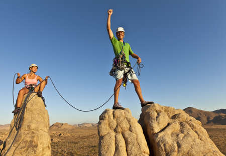tenacity: Team of rock climbers struggle to the summit of a challenging cliff.